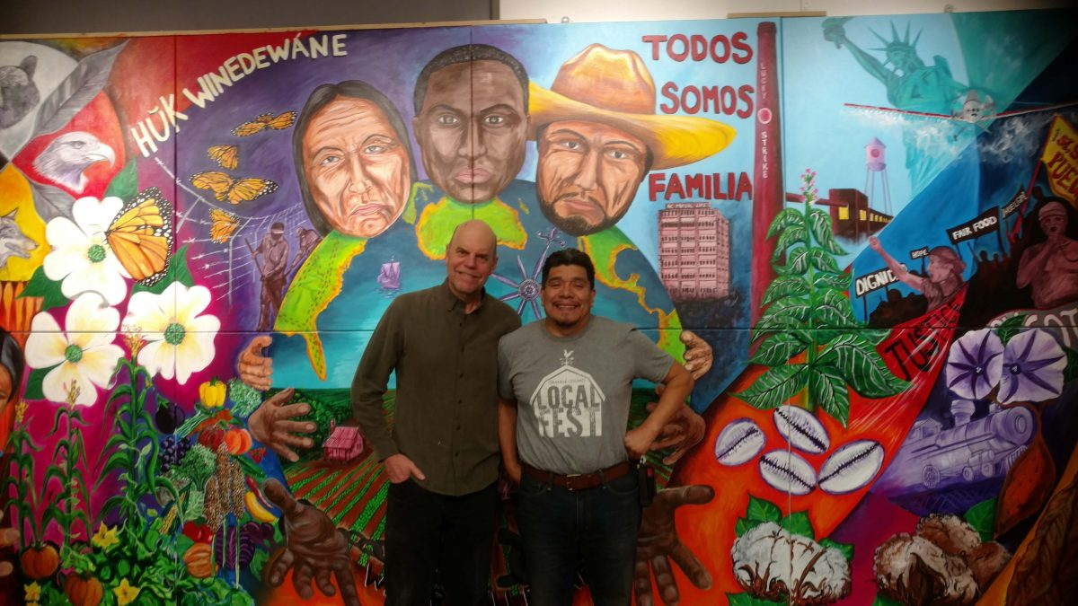 Carlie and Cornelio in front of mural