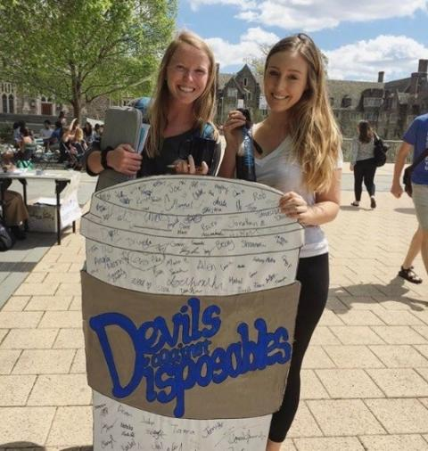 Green Devil's advertise the discount for reusble mugs on campus